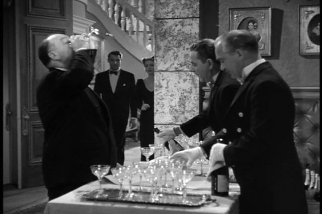 Alfred Hitchcock Presents: Gulping Champagne at the Bar
